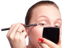 Beautiful girl and eye makeup Royalty Free Stock Photo