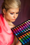Beautiful girl with eye shadow for make-up royalty free stock photography