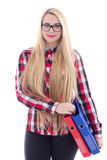 Beautiful girl in eyeglasses with long hair and books in her han Royalty Free Stock Images