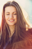 Beautiful girl with eyes closed enjoying the sun Royalty Free Stock Images