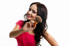 Beautiful girl with a face brush Royalty Free Stock Photos