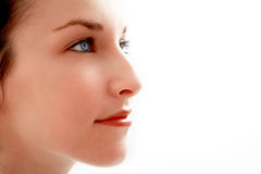 Beautiful girl - face close-up. Beautiful young woman with blue eyes - face close-up Royalty Free Stock Photography