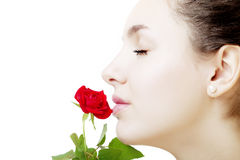 Beautiful girl face close up with a rose in hand Stock Image