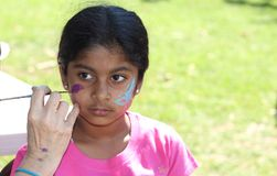 Beautiful girl face painting royalty free stock photography