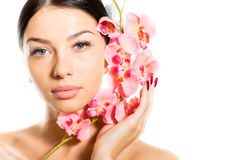 Beautiful girl face & pink flowers, perfect skin and lips on white copyspace Royalty Free Stock Photo