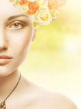 Beautiful Girl Face.Whits Perfect skin with flowers Royalty Free Stock Images