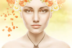 Beautiful Girl Face.Whits Perfect skin with flowers Stock Photo