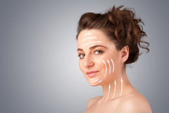 Beautiful girl with facial arrows on her skin Royalty Free Stock Image