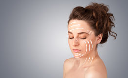 Beautiful girl with facial arrows on her skin Stock Image
