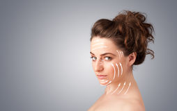 Beautiful girl with facial arrows on her skin Stock Photo