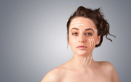 Beautiful girl with facial arrows on her skin Royalty Free Stock Photography