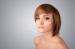 Beautiful girl with facial arrows on her skin Stock Images
