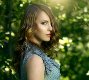 Beautiful girl in fairy forest Stock Photography