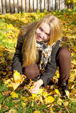Beautiful girl with fall leaves Stock Image