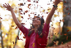Beautiful girl with falling leaves Stock Photo