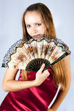 Beautiful girl with a fan. Portrait of the beautiful girl with a fan Royalty Free Stock Images