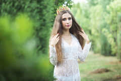 Beautiful girl. fantasy young woman in woods Royalty Free Stock Image