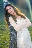 Beautiful girl in fashion dress lean on  birch Stock Image