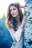 Beautiful girl in fashion dress stand by  birch Royalty Free Stock Images