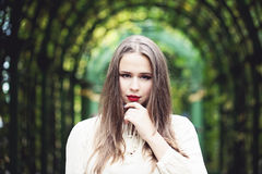 Beautiful girl fashion model in a white blouse Stock Photo