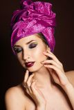 Beautiful girl with fashion purple turban on her Royalty Free Stock Photos
