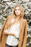 Beautiful girl fashion style in  blossom garden on a spring day Royalty Free Stock Photos