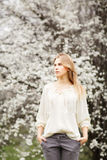 Beautiful girl fashion style in  blossom garden on a spring day Stock Photography