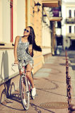 Beautiful girl is in fashion style with retro bike Stock Photos