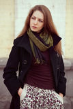 Beautiful girl in a fashionable coat Royalty Free Stock Photos
