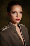 Beautiful girl in fashionable coat on dark background. Stock Photo