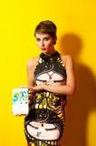 Beautiful girl in a fashionable dress Stock Photo