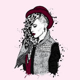 Beautiful girl with a fashionable hairstyle. The girl in a hat. Clothe. Beautiful girl with a fashionable hairstyle. The girl in a hat. Vector illustration for a Royalty Free Stock Images