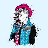 Beautiful girl with a fashionable hairstyle. The girl in a hat. Clothe. Beautiful girl with a fashionable hairstyle. The girl in a hat. Vector illustration for a Stock Images