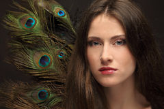 Beautiful girl and feathers Stock Photography