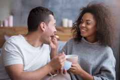 Beautiful girl feeding her boyfriend with cereals Stock Photography
