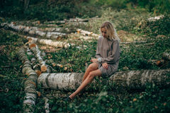 Beautiful girl in the felled forest Royalty Free Stock Photography