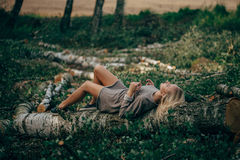 Beautiful girl in the felled forest Royalty Free Stock Photos