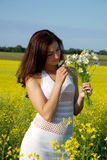 Beautiful girl on field Royalty Free Stock Images