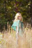 Beautiful girl in a field Stock Photo
