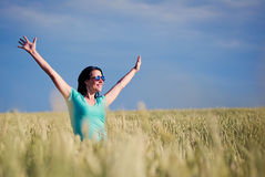 Beautiful girl in a field against the sky Royalty Free Stock Photography