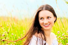 Beautiful girl in a field of flowers Royalty Free Stock Images