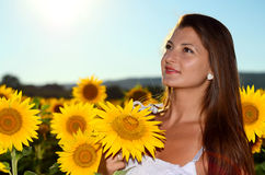 Beautiful girl in a field holding sunflower Royalty Free Stock Images