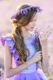 Beautiful girl in a field of lavender on sunset. stock photo