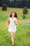 Beautiful girl in a field. Royalty Free Stock Photography