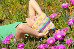 Beautiful girl on a field with pink flowers Royalty Free Stock Photography