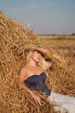 The beautiful girl in the field with wheat on the Stock Image
