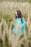 Beautiful girl in a field of wheat Royalty Free Stock Photos