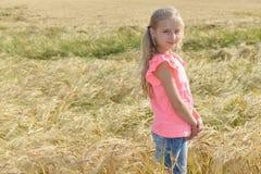 Beautiful girl in field Stock Image