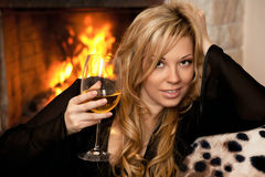 Beautiful girl by the fireplace Royalty Free Stock Photo