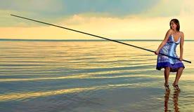 Beautiful girl fishing Stock Image